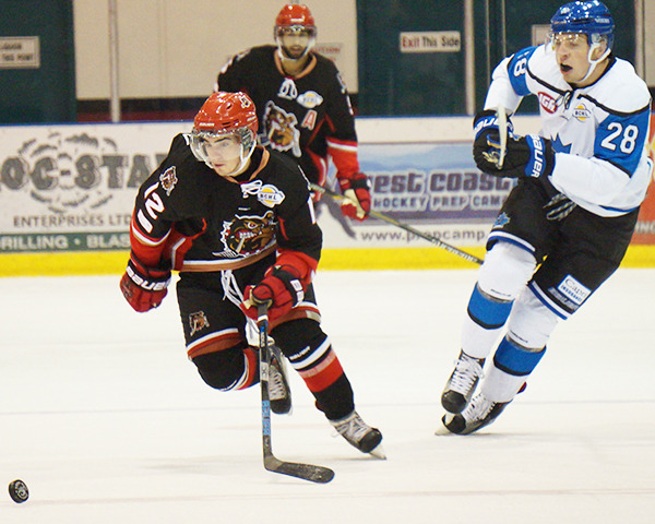 PENTICTON VEES DEFENCEMAN Kenny Johnson in action against the Alberni Valley Bulldogs shortly after signing with the team. Johnson gets tips about playing the position from his brother Jack