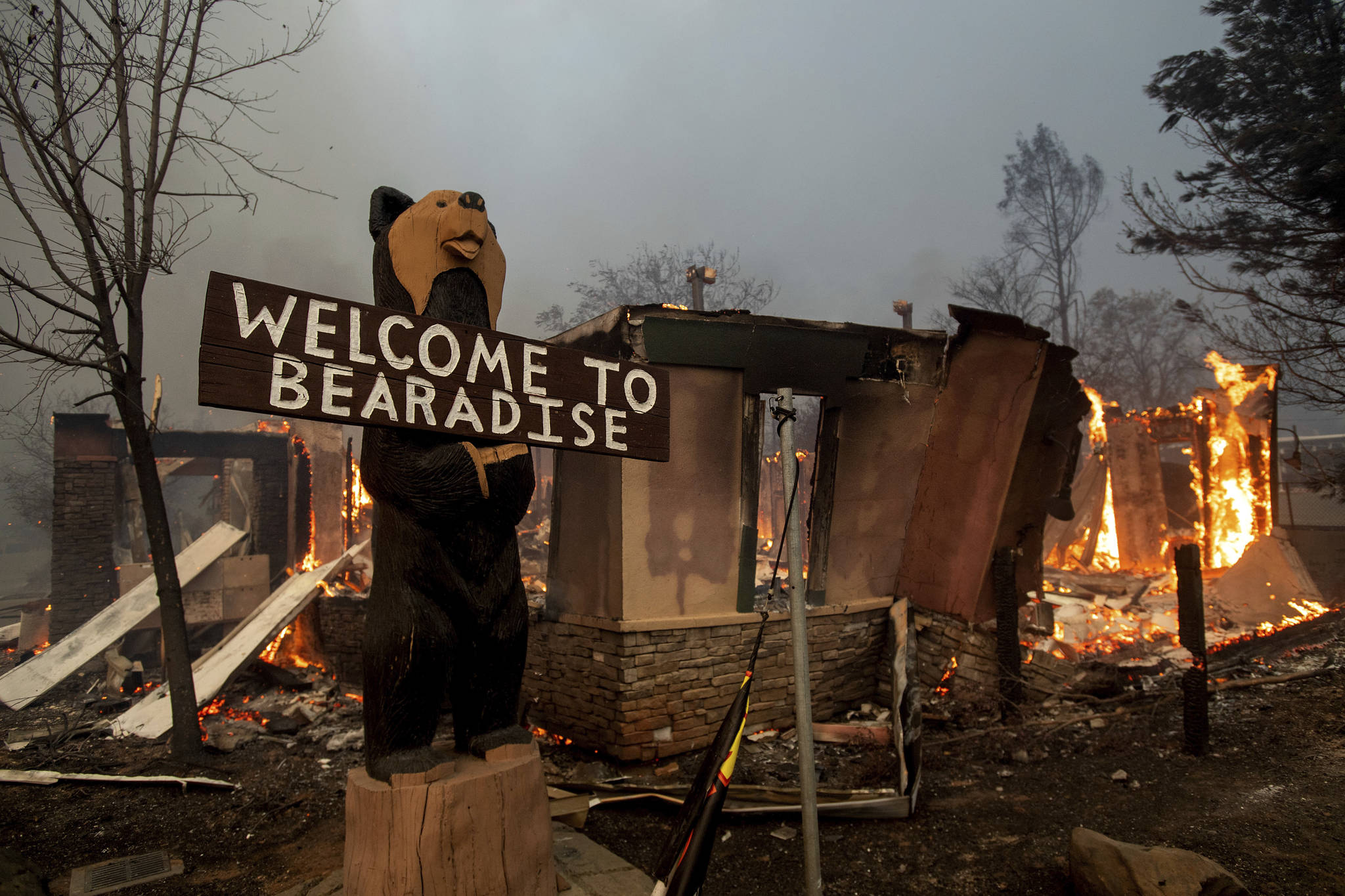 Flames consume a building as the Camp Fire tears through Paradise, Calif. A Penticton couple is in northern California helping fire evacuees.                                (AP Photo/Noah Berger)