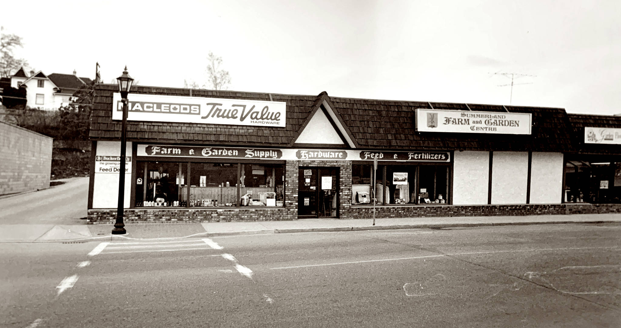 Old English design elements can be seen in the sign of the Summerland Farm and Garden Centre in 1993. The guidelines are no longer in place, but some downtown businesses still show aspects of the days when Summerland had a theme in place. This photo was taken by Summerland photographer Dan Dorotich. (Photo courtesy of the Summerland Museum)